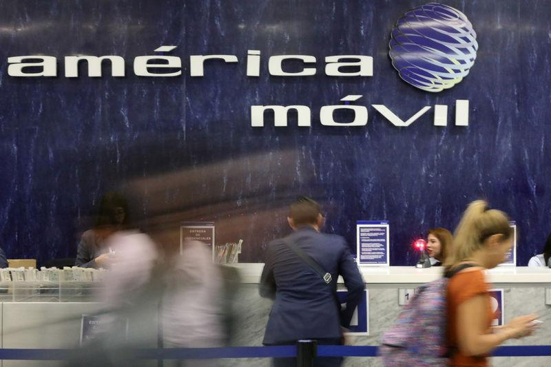 FILE PHOTO - The logo of America Movil is pictured on the wall of a reception area in the company's corporate offices in Mexico City