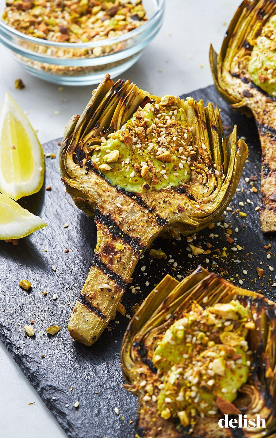 """<p>You'll be scooping out every last bite.</p><p>Get the recipe from <a href=""""https://www.delish.com/cooking/recipe-ideas/a27198662/grilled-artichoke-recipe/"""" rel=""""nofollow noopener"""" target=""""_blank"""" data-ylk=""""slk:Delish"""" class=""""link rapid-noclick-resp"""">Delish</a>. </p>"""