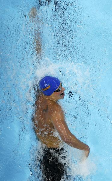 Ryan Lochte swims in the men's 400-meter individual medley final at the U.S. Olympic swimming trials, Monday, June 25, 2012, in Omaha, Neb. Lochte won the race. (AP Photo/Mark Humphrey)