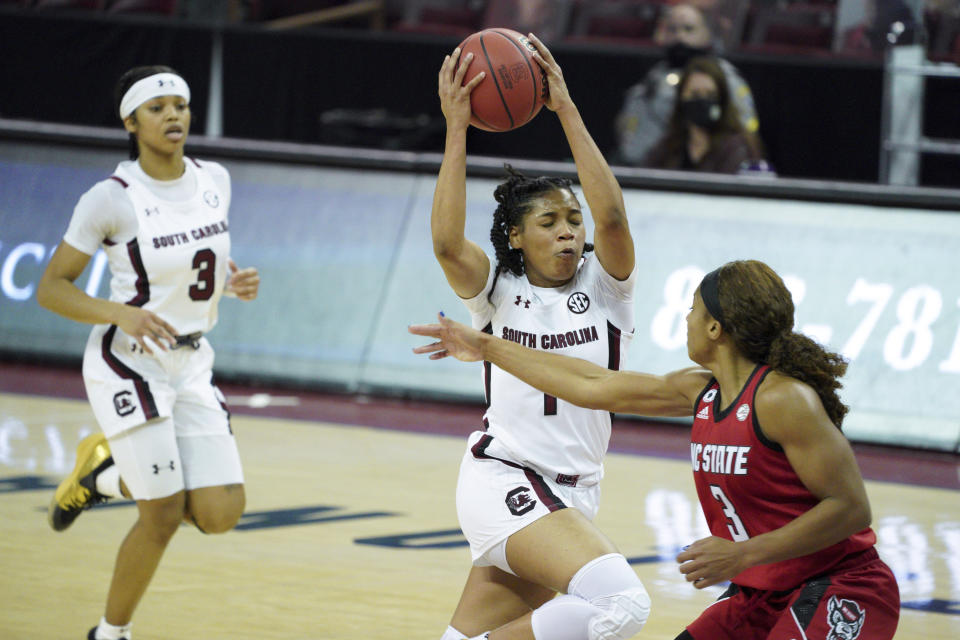 South Carolina guard Zia Cooke (1) drives to the basket against North Carolina State guard Kai Crutchfield (3) during the second half of an NCAA college basketball game Thursday, Dec. 3, 2020, in Columbia, S.C. N.C. State won 54-46. (AP Photo/Sean Rayford)
