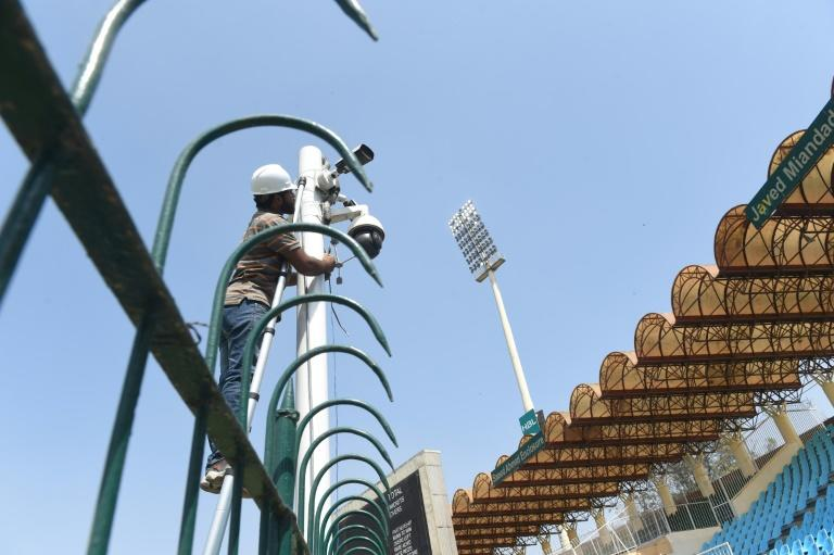 A Pakistani technician installs a security camera at the Gaddafi Cricket Stadium for the forthcoming Pakistan Super League (PSL) cricket match in Lahore (AFP Photo/ARIF ALI)