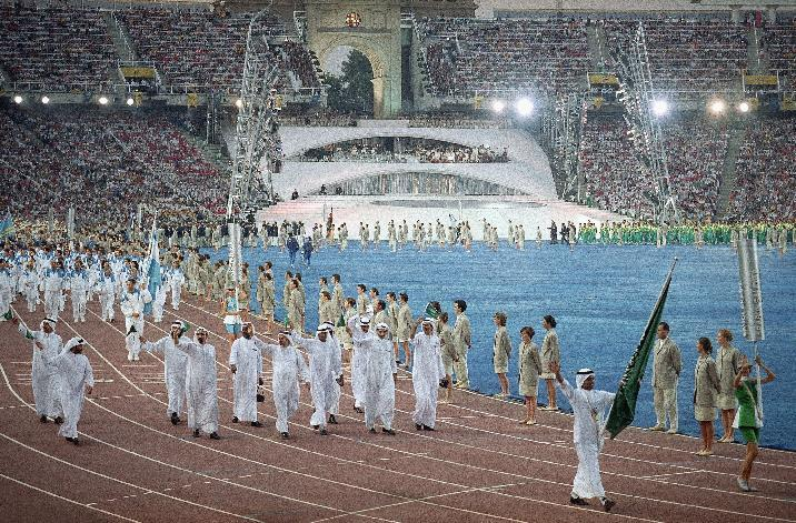 FILE - In this Saturday, July 25, 1992 file photo, members of Saudi Arabia's team walk in Olympic Stadium in Barcelona during the opening ceremonies of the XXV Olympics. Every country competing at the London Games will include female athletes for the first time in Olympic history after Saudi Arabia agreed Thursday, July 12, 2012 to send two women to compete in judo and track and field. The move by the ultraconservative Muslim kingdom to break with its practice of fielding male-only teams followed earlier decisions by Qatar and Brunei to send women athletes to the Olympics for the first time. (AP Photo/Cliff Schiappa, File)