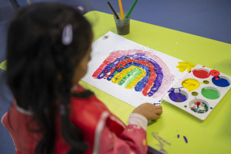 LONDON, ENGLAND - JUNE 10: A child maintains social distancing measures while painting a rainbow during a lesson at Earlham Primary School, which is part of the Eko Trust on June 10, 2020 in London, England. As part of Covid-19 lockdown measures, Earlham Primary School is teaching smaller 'bubbles' of students, to help maintain social distancing measures. School staff have put into place many safety measures such as corridor signage for a one way system, regular supervised handwashing, temperature checks on arrival and enhanced cleaning regimes to keep pupils and staff as safe as possible. Bubbles of pupils are limited to six and each have their own well-ventilated space. The Government have announced it is set to drop plans for all English primary pupils to return to school before the end of the summer. (Photo by Justin Setterfield/Getty Images)