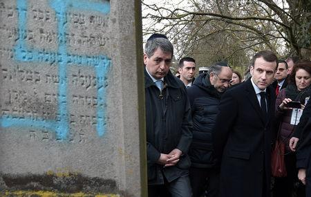 FILE PHOTO: French President Emmanuel Macron visits a Jewish cemetery in Quatzenheim