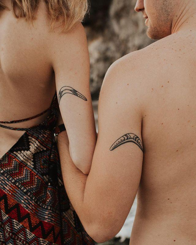 """<p>A boomerang is such a genius symbol for a couples <a href=""""http://www.cosmopolitan.com/style-beauty/beauty/a30235140/tattoo-removal-cost-methods/"""" rel=""""nofollow noopener"""" target=""""_blank"""" data-ylk=""""slk:tattoo"""" class=""""link rapid-noclick-resp"""">tattoo</a>. I like how this one is placed in identical spots right on the back of the arm.</p><p><a href=""""https://www.instagram.com/p/B38Rw5LphhQ/?utm_source=ig_embed&utm_campaign=loading"""" rel=""""nofollow noopener"""" target=""""_blank"""" data-ylk=""""slk:See the original post on Instagram"""" class=""""link rapid-noclick-resp"""">See the original post on Instagram</a></p>"""