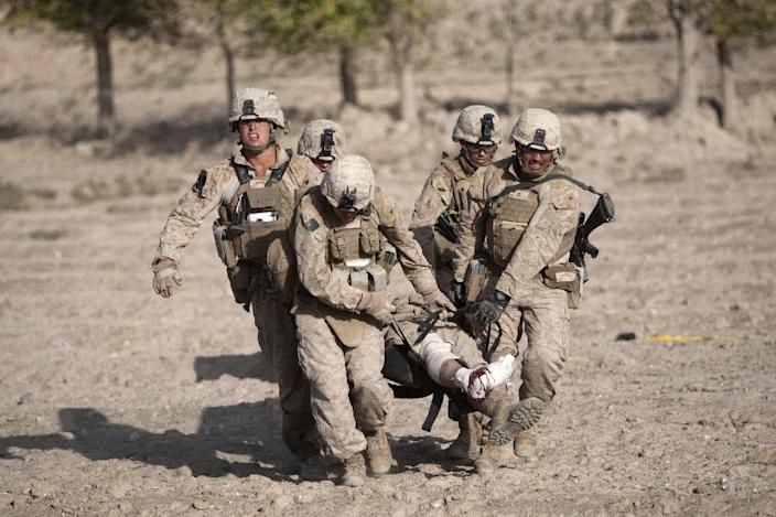 The Marines, pictured in 2011, were among the first US forces sent to Afghanistan with several thousand deployed in Helmand, where they engaged in bitter combat with Taliban (AFP Photo/Behrouz MEHRI)