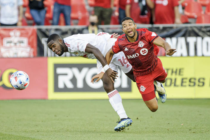 Toronto FC defender Justin Morrow (2) and New York Red Bulls midfielder Dru Yearwood (16) vie for the ball during the first half of an MLS soccer match Wednesday, July 21, 2021, in Toronto. (Chris Katsarov/The Canadian Press via AP)