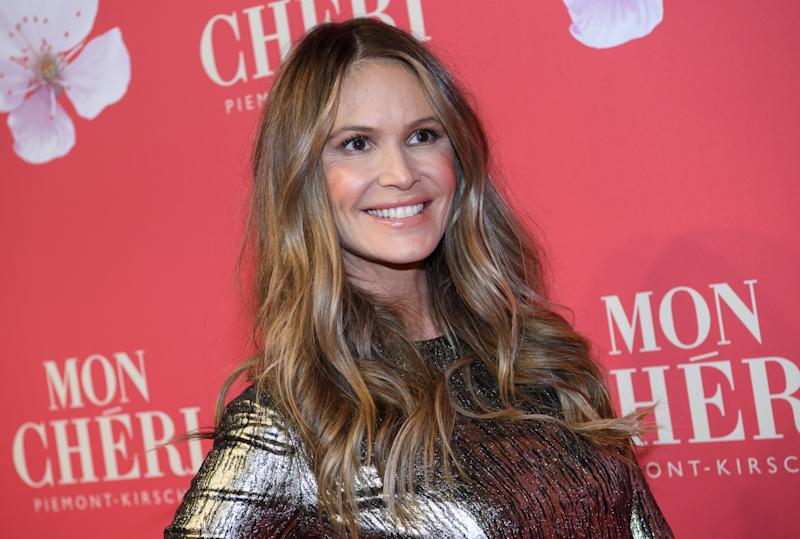 Elle Macpherson comes to the gala of the Mon Cheri Barbara Day, a PR event of the chocolate manufacturer Ferrero, at the old Bayerische Staatsbank. Here a confectionery manufacturer organizes a fundraising campaign around Barbara Day. Photo: Sven Hoppe/dpa (Photo by Sven Hoppe/picture alliance via Getty Images)