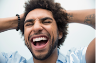 """<p>If your muscles form a smile, your brain doesn't *quite* know the difference between a real one and a fake one, which is, perhaps, why both smiling people and those who held chopsticks in their mouths to form a smile both reported lower heart rates during a stressful task, one <a href=""""https://www.ncbi.nlm.nih.gov/pubmed/23012270"""" rel=""""nofollow noopener"""" target=""""_blank"""" data-ylk=""""slk:study"""" class=""""link rapid-noclick-resp"""">study</a> found.</p>"""