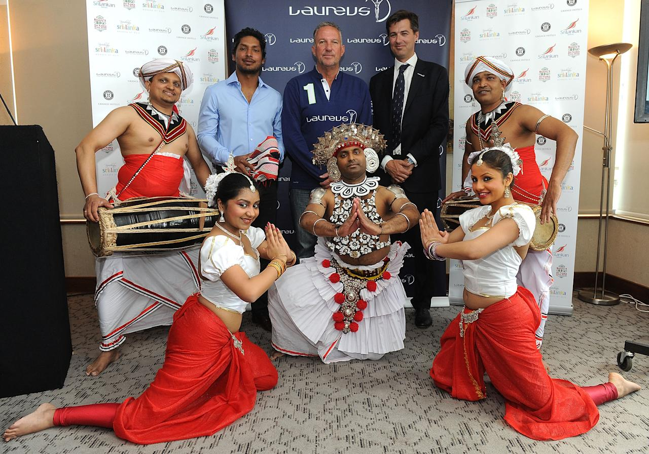 LONDON, ENGLAND - JUNE 12: A trustee of the Foundation of Goodness, Kumar Sangakkara (L) poses for photos with Sir Ian Botham (C), Laureus Academy Member and Global Director of the Laureus Sport for Good Foundation, Ned Wills and the dancers during the Sri Lanka Walk Launch on June 12, 2013 in London, England. (Photo by Getty Images for Laureus)