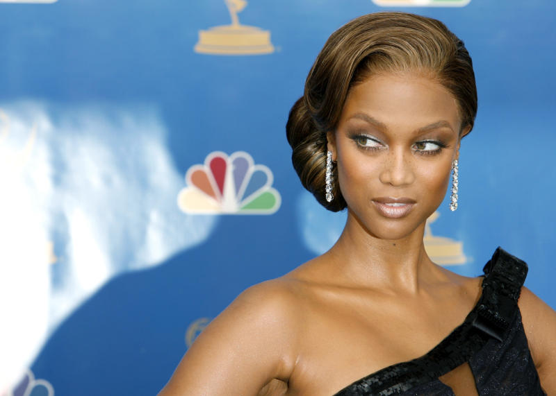 Actress and model Tyra Banks poses for photographers backstage at the 58th annual Primetime Emmy Awards at the Shrine Auditorium in Los Angeles August 27, 2006. REUTERS/Mario Anzuoni (UNITED STATES)
