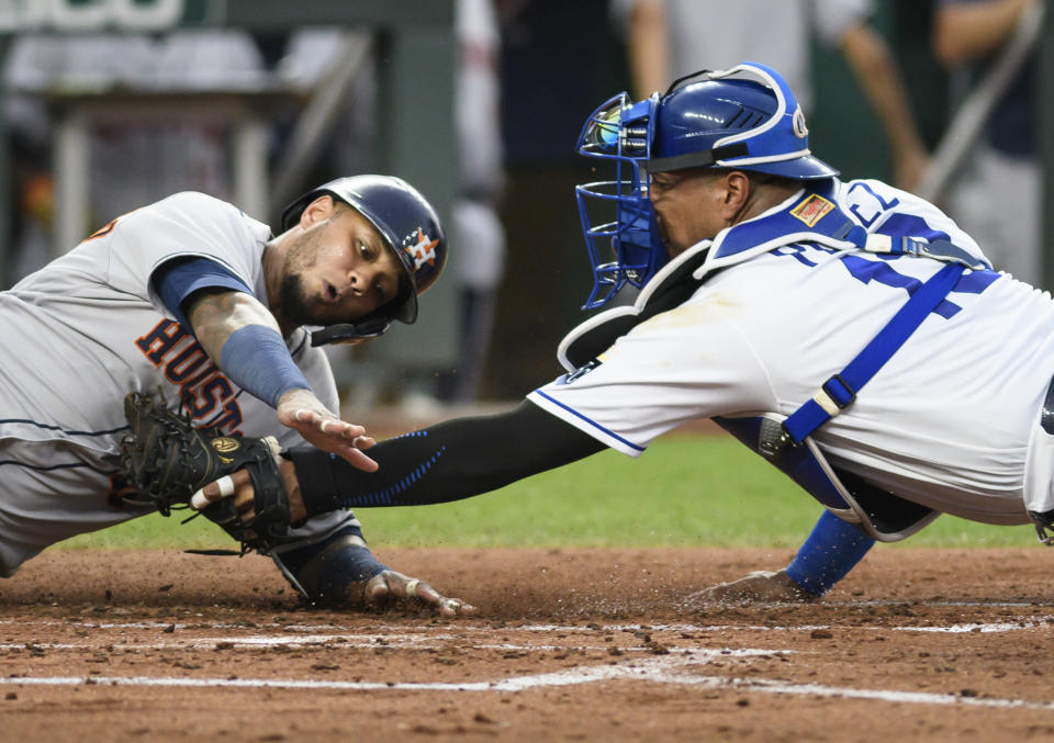 Houston Astros' Martin Maldonado is tagged out at home by Kansas City Royals catcher Salvador Perez during the third inning of a baseball game Tuesday, Aug. 17, 2021, in Kansas City, Mo. (AP Photo/Reed Hoffmann)