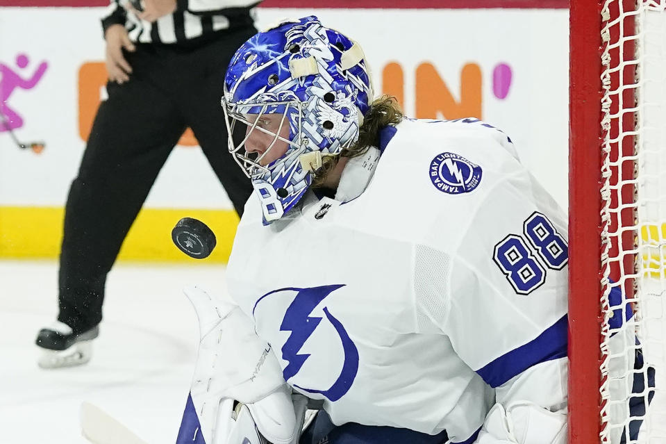 Tampa Bay Lightning goaltender Andrei Vasilevskiy (88) blocks a shot on goal during the second period in Game 5 of an NHL hockey Stanley Cup second-round playoff series against the Carolina Hurricanes in Raleigh, N.C., Tuesday, June 8, 2021. (AP Photo/Gerry Broome)