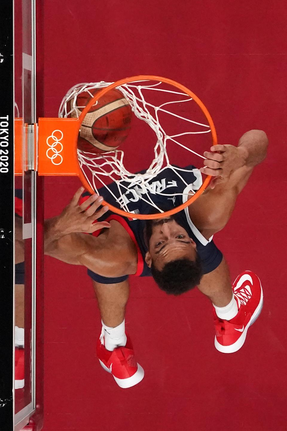 <p>France's Rudy Gobert dunks the ball in the men's preliminary round group A basketball match between Iran and France during the Tokyo 2020 Olympic Games at the Saitama Super Arena in Saitama on July 31, 2021. (Photo by Brian SNYDER / POOL / AFP)</p>