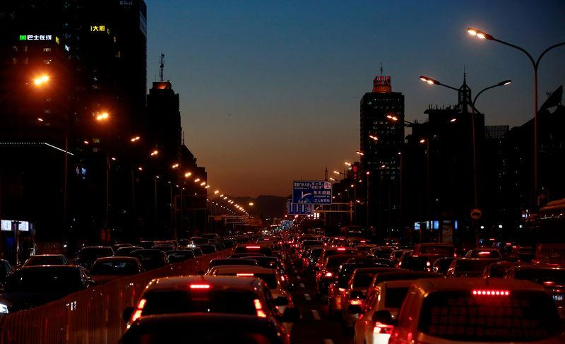 Cars stand bumper to bumper in the evening rush hour traffic in central Beijing