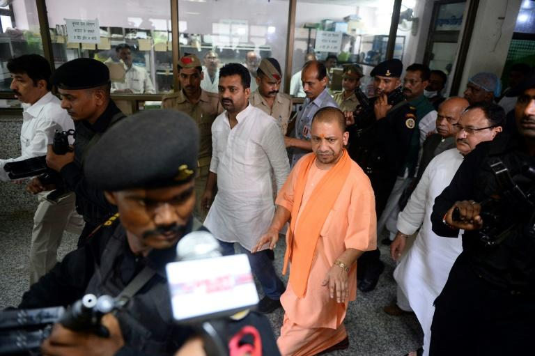 Chief Minister of Uttar Pradesh (UP), Yogi Adityanath walks out after a visit to the Baba Raghav Das Hospital in Gorakhpur, in the northern Indian state of Uttar Pradesh, on August 13, 2017