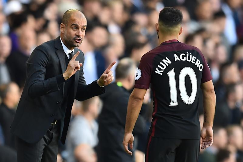 Manchester City's manager Pep Guardiola (L) has expressed confidence in his striker Sergio Aguero (R) after the player had a disappointing week on international duty for Argentina (AFP Photo/Glyn Kirk)