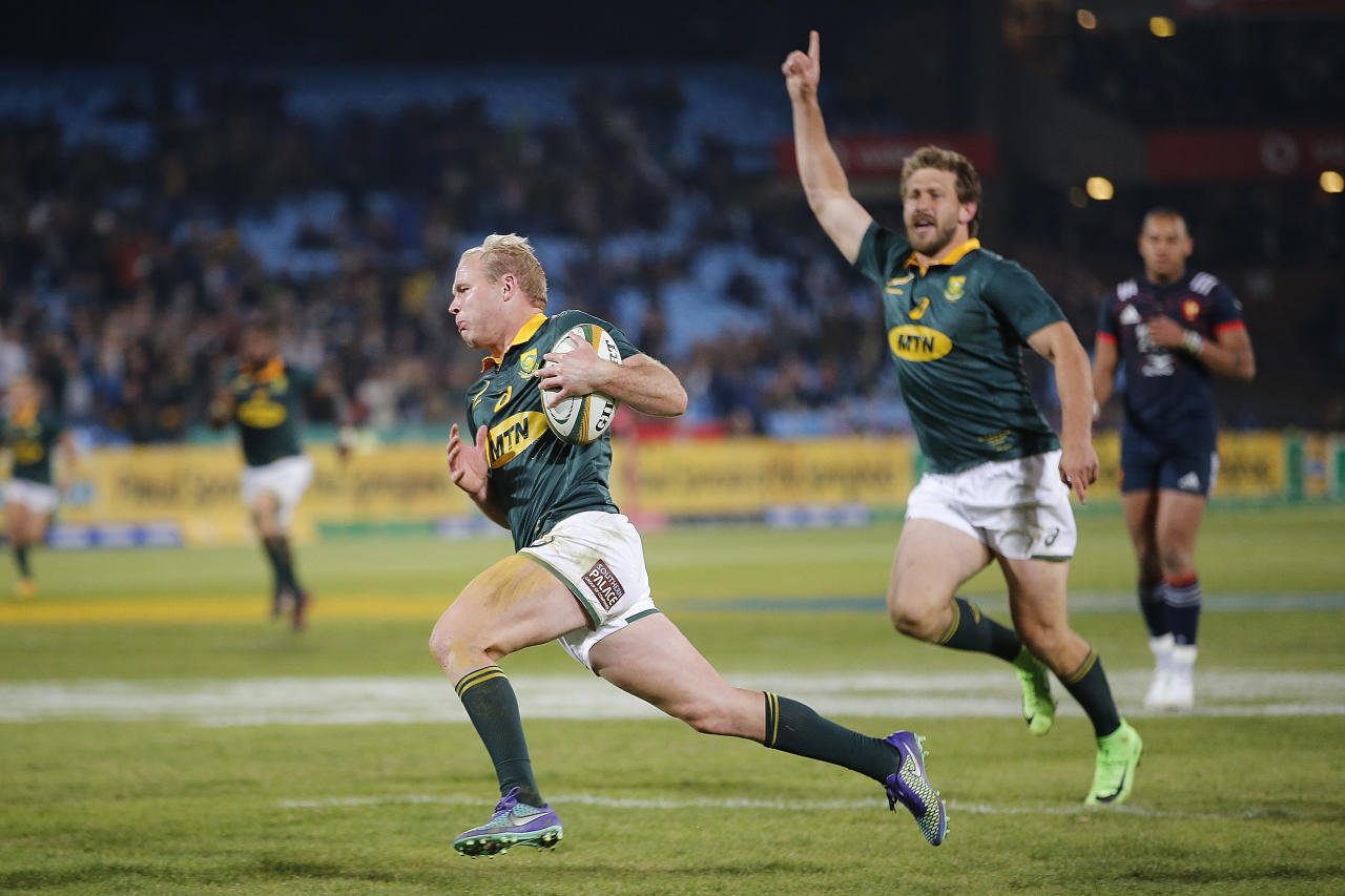 South Africa's scrum half Ross Cronje runs to score a try during the first rugby union Test match between South Africa and France at the Loftus Versfeld Arena in Pretoria on June 10, 2017. (AFP Photo/MARCO LONGARI)