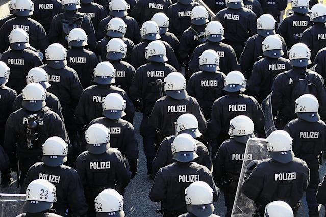 <p>German riot police stand in front of protestors during the demonstrations during the G-20 summit in Hamburg, Germany, July 6, 2017. (Photo: Fabrizio Bensch/Reuters) </p>