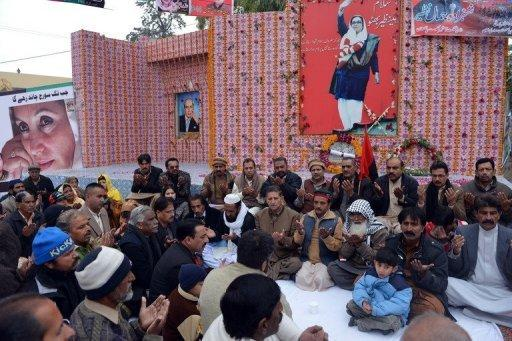 <p>Pakistan Peoples Party supporters offer prayers for former premier Benazir Bhutto in Rawalpindi on Thursday at the site where she was assassinated. Bhutto's son Bilawal launched his political career Thursday, vowing to continue her fight for democracy.</p>
