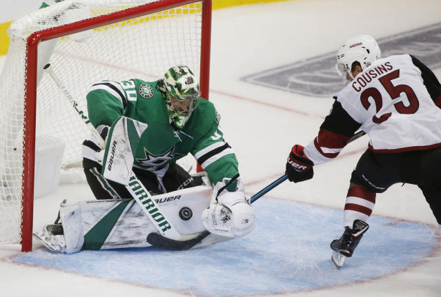 Dallas Stars goaltender Ben Bishop (30) makes a save on a shot by Arizona Coyotes center Nick Cousins (25) during the second period of an NHL hockey game in Dallas, Thursday, Oct. 4, 2018. (AP Photo/Michael Ainsworth)