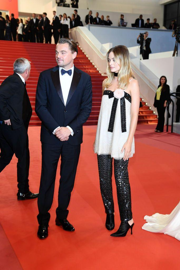 <p>Margot Robbie arrives for the Cannes film festival showing of Once Upon A Time... In Hollywood, on the arm of Leonardo Dicaprio, wearing head-to-toe Chanel.</p>