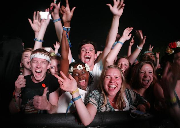 Fans scream as Kanye performs at Bonnaroo [photo: Wade Payne/Invision/AP]