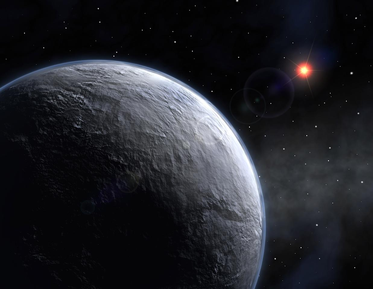 A newly discovered planet, designated by the unglamorous identifier of OGLE-2005-BLG-390Lb, orbits a red star five times less massive than the Sun and located at a distance of about 20,000 light years, in this undated artist's impression. A new planet-hunting technique has detected the most Earth-like planet yet around a star other than our sun, raising hopes of finding a space rock that might support life, astronomers reported on January 25, 2006. REUTERS/ESO/Handout