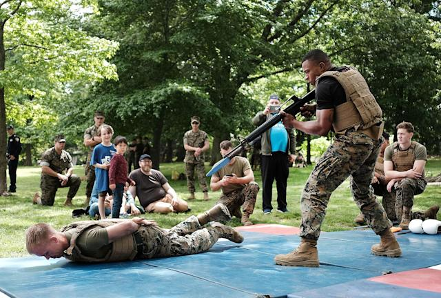 """<p>Members of the U.S. Marine Corps (USMC) demonstrate their fighting skills in Brooklyn's Prospect Park as part of Fleet Week on May 27, 2017 in New York City. At """"Marines Day"""" in the park members of the public had the opportunity to test their strength on chin-up bars, hold military weapons and watch as Marines display their fighting skills.Now in its 29th year, Fleet Week brings more than 3,700 U.S. and Canadian service members to Manhattan through Memorial Day. The event includes ship tours, military demonstrations, musical performances and other events. (Photo: Spencer Platt/Getty Images) </p>"""