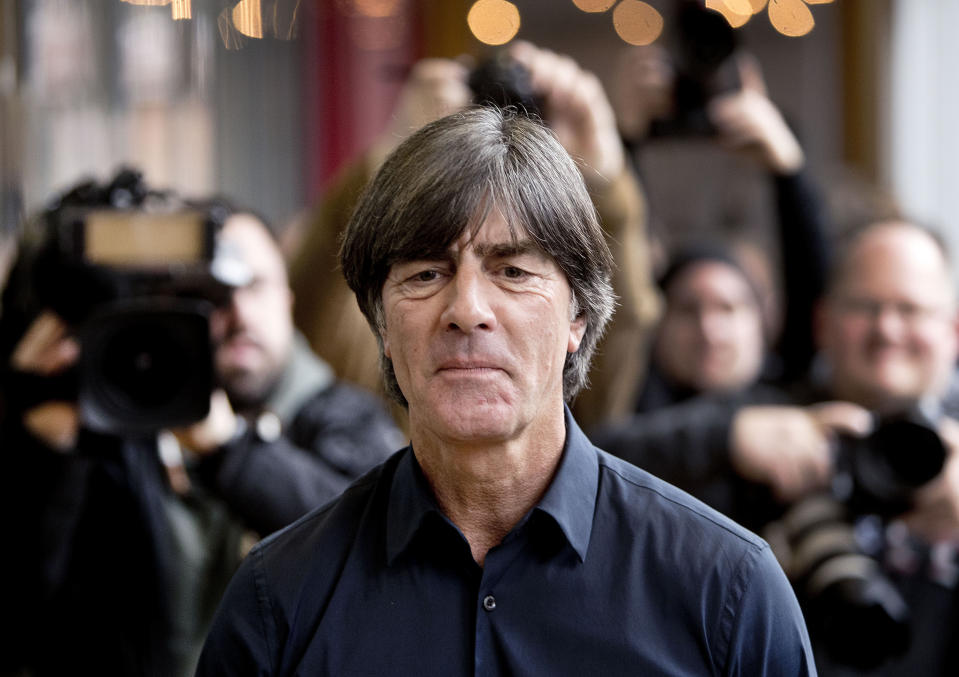 FILE - In this March 15, 2019, file photo,Coach of German national soccer team Joachim Loew is on his way to a news conference in Frankfurt, Germany. (AP Photo/Michael Probst,File)