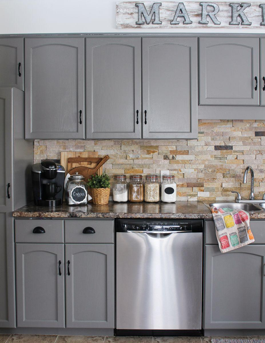 """<p>The color (<a href=""""https://www.benjaminmoore.com/en-us/color-overview/find-your-color/color/HC-168/chelsea-gray?color=HC-168"""" rel=""""nofollow noopener"""" target=""""_blank"""" data-ylk=""""slk:Chelsea Gray by Benjamin Moore"""" class=""""link rapid-noclick-resp"""">Chelsea Gray by Benjamin Moore</a>) instantly elevated the kitchen—as did swapping out the dated drawer pulls for cup pulls.</p><p><strong>Get the tutorial at <a href=""""http://www.littledekonings.com/kitchen-cabinet-makeover/"""" rel=""""nofollow noopener"""" target=""""_blank"""" data-ylk=""""slk:LittleDekonings.com"""" class=""""link rapid-noclick-resp"""">LittleDekonings.com</a>.</strong></p><p><strong><a class=""""link rapid-noclick-resp"""" href=""""https://www.benjaminmoore.com/en-us/color-overview/find-your-color/color/HC-168/chelsea-gray?color=HC-168"""" rel=""""nofollow noopener"""" target=""""_blank"""" data-ylk=""""slk:SHOP CHELSEA GRAY"""">SHOP CHELSEA GRAY</a><br></strong></p>"""