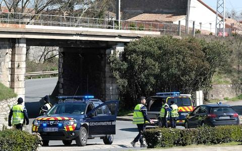 French gendarmes block the access to Trebes, where a man took hostages at a supermarket - Credit: ERIC CABANIS/AFP