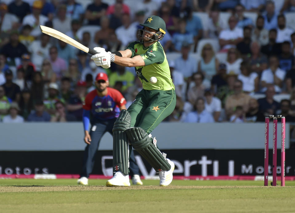 Pakistan's Shaheen Shah Afridi attempts to play a shot during the second Twenty20 international cricket match between England and Pakistan at Headingley in Leeds, Sunday, July 18, 2021. (AP Photo/Rui Vieira)