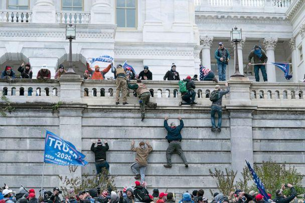 PHOTO: Supporters of President Donald Trump climb the west wall of the the U.S. Capitol, Jan. 6, 2021.  (Jose Luis Magana/AP)