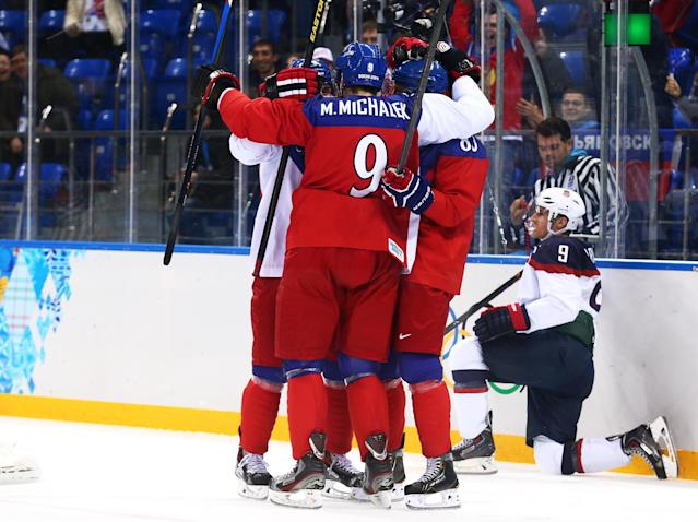 SOCHI, RUSSIA - FEBRUARY 19: Ales Hemsky #83 of the Czech Republic (obscured - L) is congratulated by teammates after scoring a goal against Jonathan Quick #32 of the United States in the first period during the Men's Ice Hockey Quarterfinal Playoff on Day 12 of the 2014 Sochi Winter Olympics at Shayba Arena on February 19, 2014 in Sochi, Russia. (Photo by Clive Mason/Getty Images)
