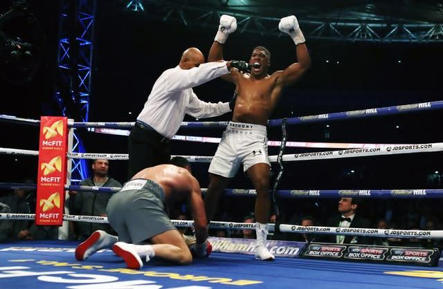 Anthony Joshua knocks down Wladimir Klitschko during their IBF, WBA and IBO heavyweight world title bout at Wembley Stadium. Joshua produced the performance of his career in front of 90,000 fans, delivering the clinical blows in the 11th round (Nick Potts/PA)