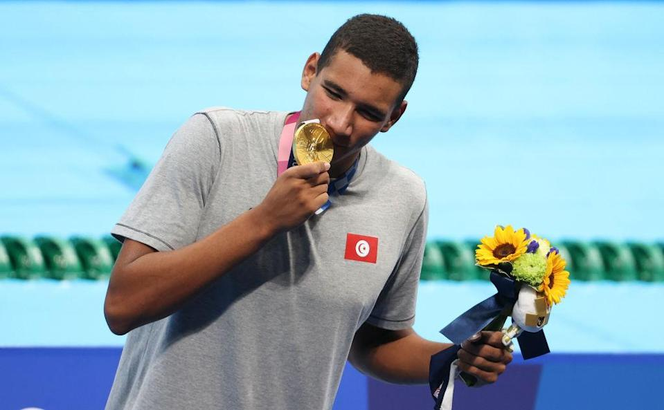 """Gold medalist Ahmed Hafnaoui of Tunisia during the medals ceremony of the 400-m freestyle final on day two of the Tokyo 2020 Olympic Games at Tokyo Aquatics Centre on July 25, 2021 in Tokyo, Japan.<span class=""""copyright"""">Jean Catuffe—Getty Images</span>"""