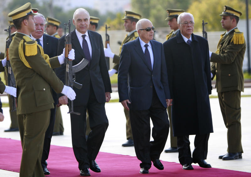 Arab League Secretary-General Nabil Elaraby, second right, and Egyptian foreign Minister Mohamed Kamel Amr, third right, walk past an honor guard during an arrival ceremony in the West Bank city of Ramallah, Saturday, Dec. 29, 2012. (AP Photo/Majdi Mohammed)