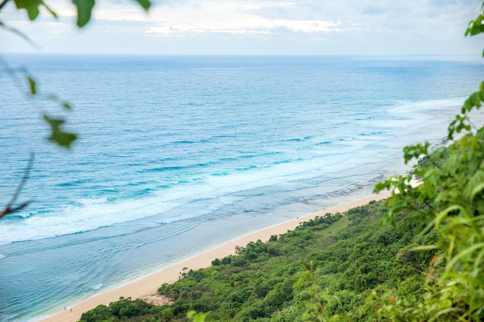 """<p><strong>What kind of beach are we talking about?</strong><br> In Bali, the words """"south"""" and """"secluded"""" are rarely uttered in the same sentence, but Nyang Nyang Beach, in Uluwatu, indeed fills the bill. White sands, greenery-lined cliffs, and the astonishing absence of crowds await—if you're dedicated enough to find it. Who knows, you might get lucky and have the spread all to yourself.</p> <p><strong>How accessible is it?</strong><br> There's a reason this beach remains deserted: There are no billboard-sized signs along the road pointing the way, and when you do find the parking lot, it requires a 20- or 30-minute descent down a steep, jungled hillside with some 500 steps. If that hasn't scared you off, the effort will be well worth it. But bring everything you need; after all, the trade-off for a pristine, crowd-free beach is the absence of loungers and limited food vendors.</p> <p><strong>What's the water like? The sand?</strong><br> The big, blue waves here are kinder to surfers than swimmers. You can still take a cautious dip—just mind the sharp rocks and rock pools farther into the shallow waters. Also, there are no lifeguards.</p> <p><strong>What should we be sure to check out?</strong><br> There's a half-buried shipwreck decorated by graffiti art that begs to be photographed.</p> <p><strong>Why would you recommend this beach in particular?</strong><br> If you've lamented how overrun Bali's main beaches have become nowadays, Nyang Nyang is the respite you've been looking for.</p>"""
