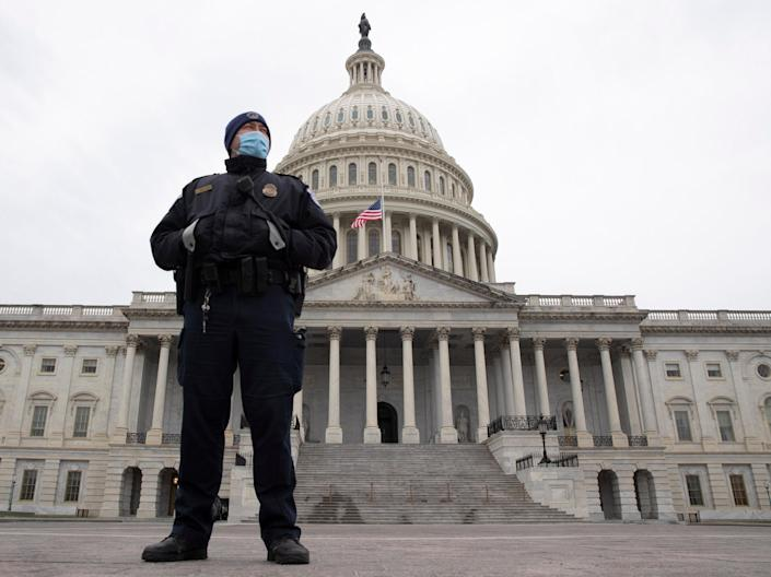<p>A Capitol Police officer stands at the East Front of the US Capitol</p> ((EPA))