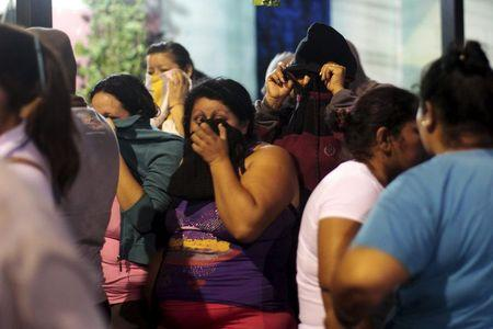 Relatives wait for news outside a prison where 14 members of the Barrio 18 group were killed in Quezaltepeque, El Salvador August 22, 2015. REUTERS/Jose Cabezas