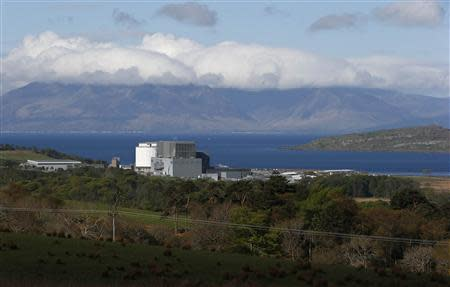 The Isle of Mull is seen behind Hunterston nuclear power station in West Kilbride, Scotland May 15, 2013. REUTERS/Suzanne Plunkett