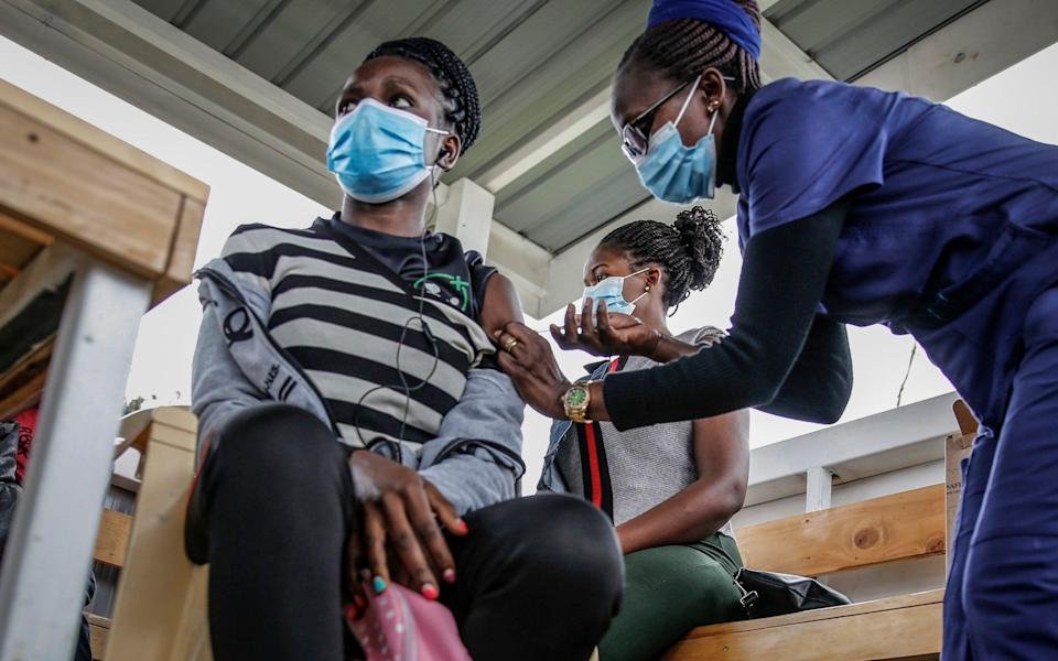 """The international community is not currently living up to promises """"to vaccinate the world"""" - AP Photo/Brian Inganga"""