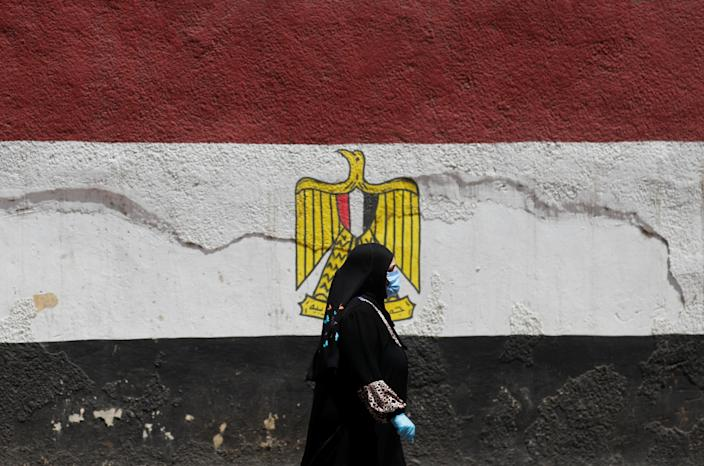 A woman wearing a protective face mask and gloves in Cairo. (Amr Abdallah Dalsh/Reuters)