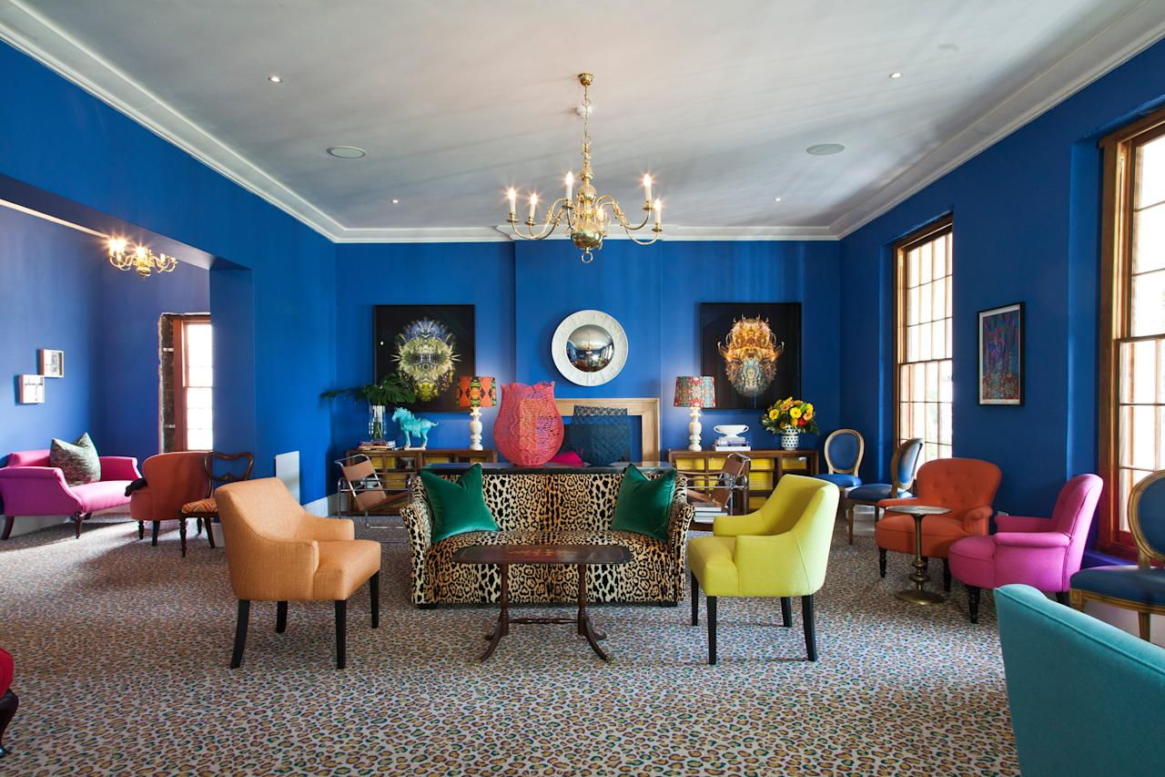"""<p><strong>Tell us about your first impressions when you arrived.</strong><br> Tucked into a narrow street behind the <a href=""""https://www.cntraveler.com/hotels/south-africa/cape-town/mount-nelson-hotel-cape-town?mbid=synd_yahoo_rss"""">Mount Nelson Hotel</a> in Gardens, the Stack is partly a private-members' club (upstairs) and a brasserie and bar open to the public (downstairs). It's housed in a two-story Victorian mansion, known as Leinster Hall. All the rooms are elegantly proportioned, some with decorative, pressed-steel ceilings. Glamorous, yet quirky, interiors definitely poke fun at old-school gentlemen's clubs. <a href=""""https://www.sarahord.com/"""">Sarah Ord Interiors</a> went wild with flamboyant color and pattern to great effect, adding carefully selected antique furniture, historical books, customized art and more shots of color in exotic floral arrangements. The result? Extreme comfort, yet visually stimulating.</p> <p><strong>What was the crowd like?</strong><br> You won't find any old boys skulking in the bar here, reminiscing about their school days. Instead, many of the members are relatively young, and work in creative industries or travel. The upstairs members area is used as a mobile office or for meetings. Downstairs, the bar and brasserie offers privacy and respite from the city's popular, crowded hangouts.</p> <p><strong>What should we be drinking?</strong><br> The barmen will dream up a cocktail to suit your personality. There's also a snappy little wine list that includes some lovely choices by the glass.</p> <p><strong>Main event: the food. Give us the lowdown—especially what not to miss.</strong><br> French classics prevail, like fresh oysters with a red wine shallot and lemon dressing, French onion soup, and chicken liver parfait. For mains, coq au vin, pan-fried linefish with cauliflower purée, charred cauliflower florets, almonds, capers, sultanas and crispy sage, or steak frites with Béarnaise. There are some lovely sides, like charred broc"""