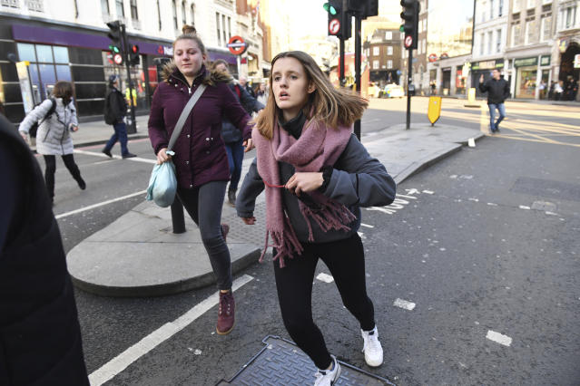 People are evacuated from London Bridge in central London following a police incident, Friday, Nov. 29, 2019. Photo: Dominic Lipinski/PA via AP