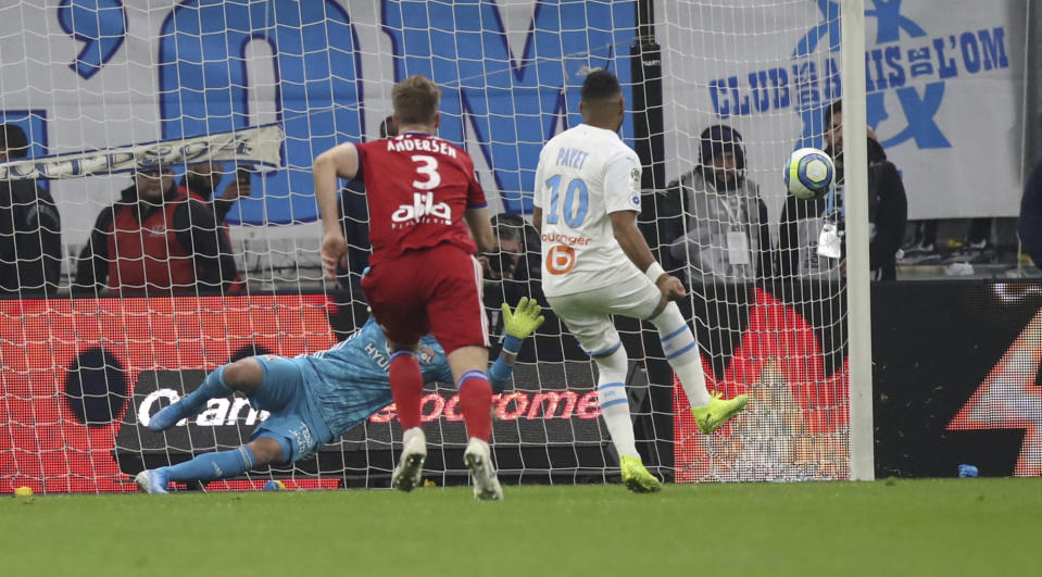 Marseille's Dimitri Payet scores a penalty during the French League One soccer match between Marseille and Lyon at the Velodrome stadium in Marseille, southern France, Sunday, Nov. 10, 2019. (AP Photo/Daniel Cole)