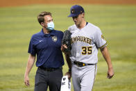 Milwaukee Brewers starting pitcher Brent Suter (35) leaves a baseball game during the third inning against the Miami Marlins, Friday, May 7, 2021, in Miami. (AP Photo/Lynne Sladky)