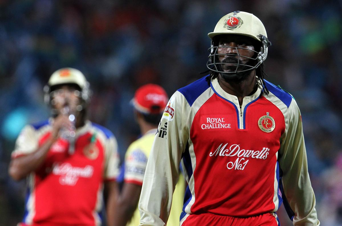 Royal Challengers Bangalore player Chris Gayle walks back to the pavilion after getting out during match 46 of the Pepsi Indian Premier League ( IPL) 2013  between The Pune Warriors India and the Royal Challengers Bangalore held at the Subrata Roy Sahara Stadium, Pune on the 2nd May 2013..Photo by Vipin Pawar-IPL-SPORTZPICS  ..Use of this image is subject to the terms and conditions as outlined by the BCCI. These terms can be found by following this link:..https://ec.yimg.com/ec?url=http%3a%2f%2fwww.sportzpics.co.za%2fimage%2fI0000SoRagM2cIEc&t=1492950227&sig=8jaa2aZSR34cNQgMxBAJbQ--~C