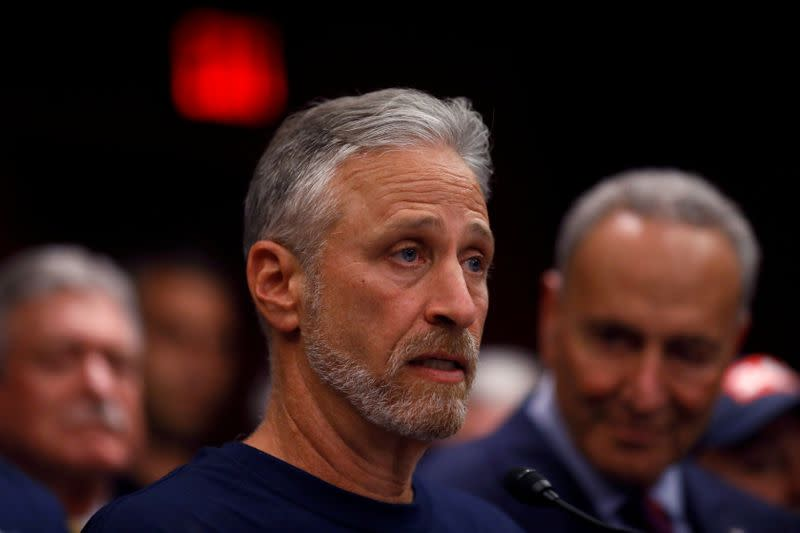 """FILE PHOTO: Jon Stewart, former host of Comedy Central's """"The Daily Show"""" speaks at a news conference following the Senate vote on the """"Never Forget the Heroes Act"""" on Capitol Hill in Washington"""
